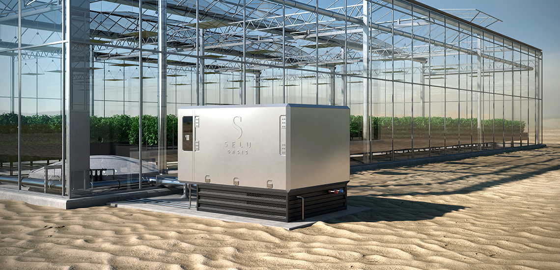 Image of the Selu System next to a modern greenhouse in the desert - Selu Technologies